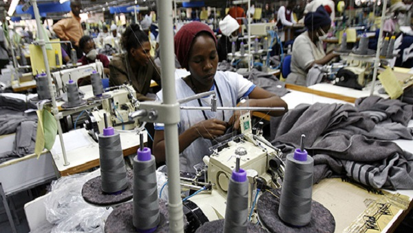 File Photo of workers prepare clothes for export in Africa.