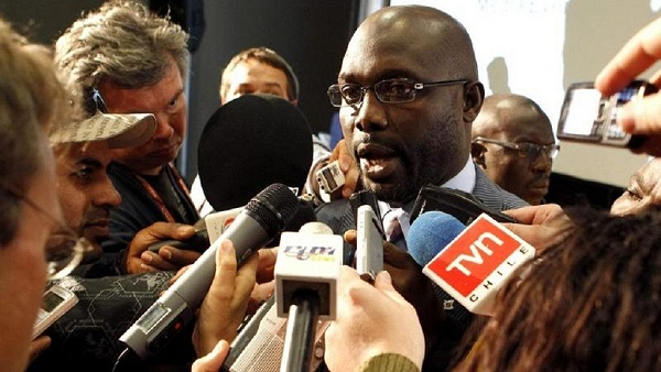 Former footballer George Weah speaks to journalists