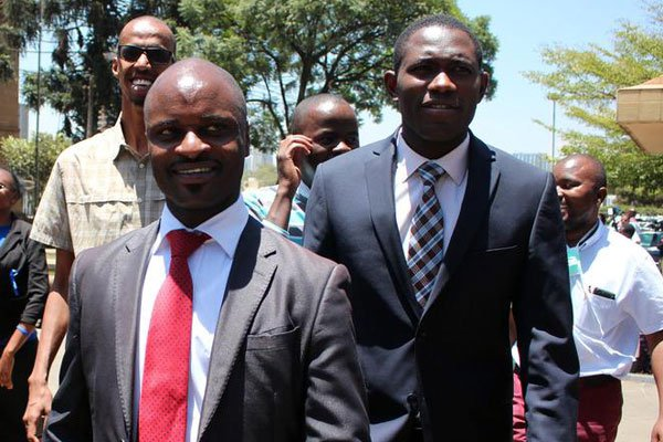 Kenya Medical Practitioners, Pharmacists and Dentists Union (KMPDU) Chair Samuel Oroko (in front) and Secretary General Ouma Oluga (right) outside the Supreme Court . PHOTO   DENNIS ONSONGO   NATION MEDIA GROUP