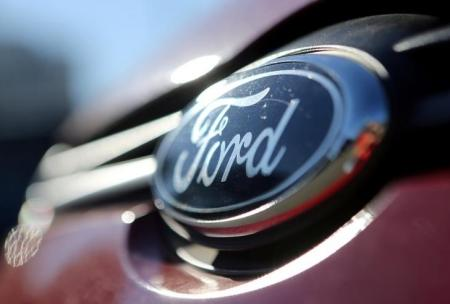 The Ford logo is seen on a car in a park lot in Sao Paulo, Brazil June 2, 2017.  REUTERS/Paulo Whitaker