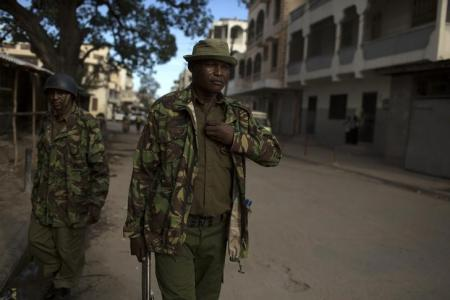 Police officers patrol a street.  File Photo: REUTERS/Siegfried Modola