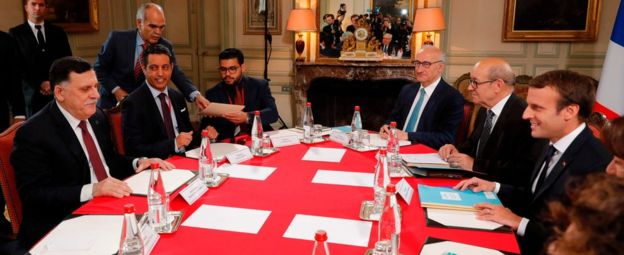 French President Emmanuel Macron (far right) also met with Mr Sarraj (far left) on Tuesday. Photo: AFP