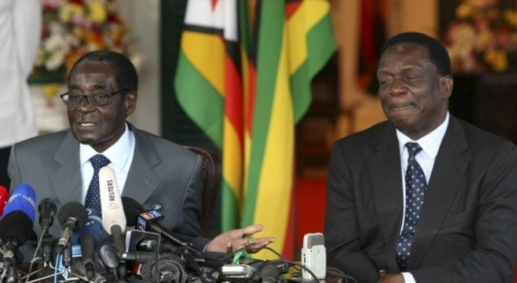 Zimbabwean President Emmerson Mnangagwa (R) and his former boss Robert Mugabe (L) at a public event in the past.