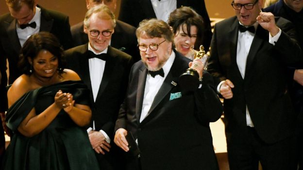 The Shape of Water director Guillermo del Toro celebrates their best picture win. Photo: GETTY IMAGES