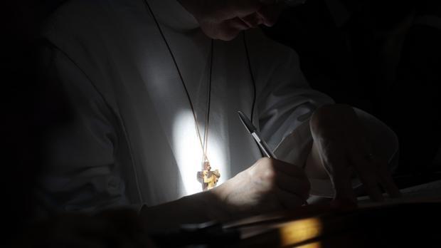 Pastor or Catholic priest