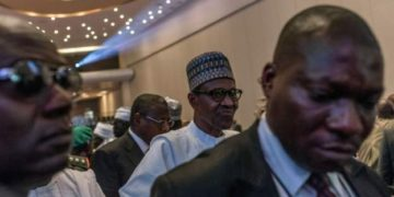 President Buhari is pictured here leaving an APC rally in March. Photo: AFP