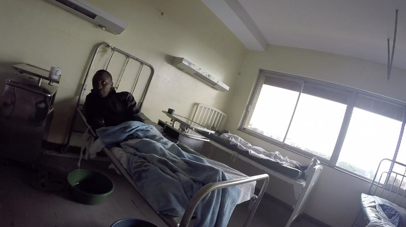 Detained patients lie on beds in the Kenyatta National Hospital. (AP Photo/Desmond Tiro)