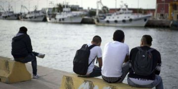 Africans sit by the river Tiber, in Fiumicino, Italy. File Photo: