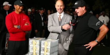 Phil Mickelson (right) reacts after the winner's belt didn't fit as Tiger Woods (left) looks on after The Match. Photo: Credit: Rob Schumacher-USA TODAY Sports