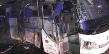 Images show the bus was badly damaged