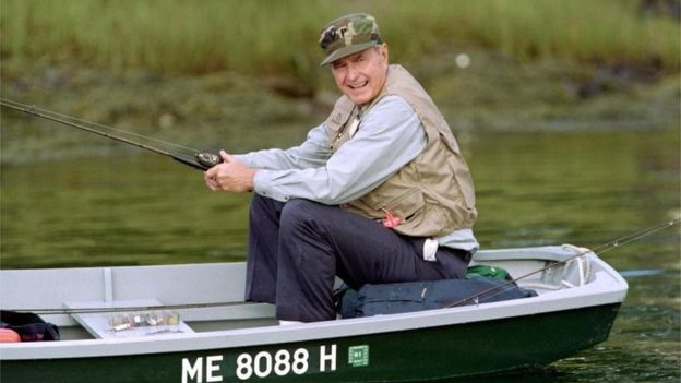 Bush enjoying some downtime on the Kennebunk River in 1990. Photo: AFP