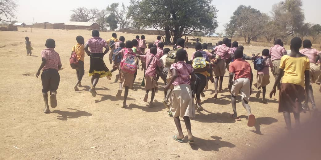 The pupils are exposed to bee attack for lack of classrooms. Photo credit: Starrfm.com.gh