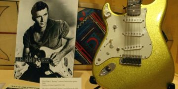 An early photo of Dick Dale alongside a custom Fender guitar at an exhibit in California. Photo: Getty Images