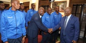 Magufuli (R) meeting members of the Tanzania national football team. Photo: The Citizen