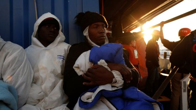 Migrants rest on the rescue ship Alan Kurdi. Photo: Reuters