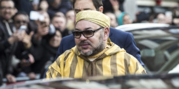 King Mohammed VI of Morocco is surrounded by supporters and admirers as he leaves his hotel in Amsterdam. Photo: ALEXANDER SCHIPPERS/AFP/Getty Images