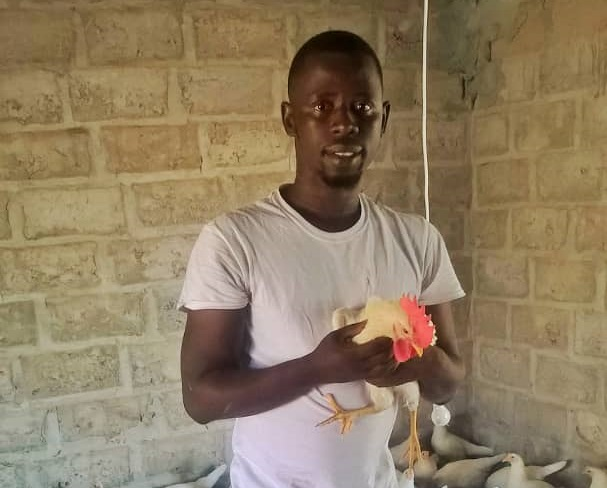 Joseph Dilliah with one of his birds at the poultry farm. Photo: Africa Feeds Media