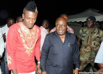 File Photo: Asamoah Gyan (L) with Ghana's President (R).
