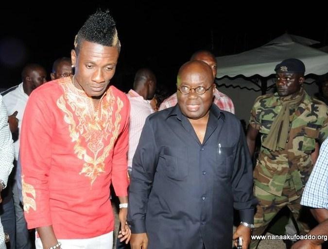 File Photo: Asamoah Gyan (L) with Ghana's President (R).