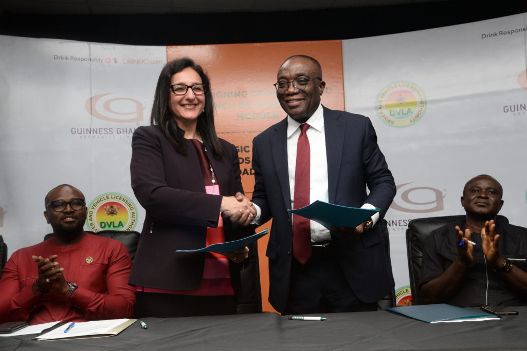 Officials of Guinness Ghana and the Driver and Vehicle Licensing Authority (DVLA) at a signing ceremony