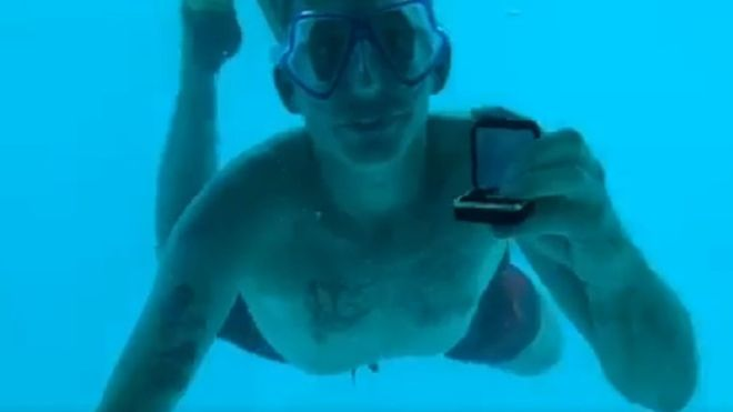 Man proposes under water