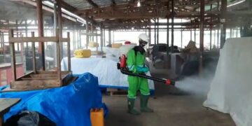 Spraying markets in Ghana