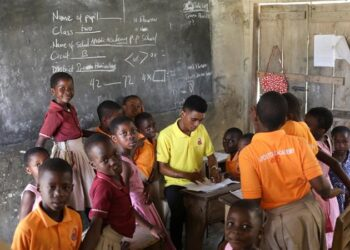 Pupils gather around their teacher in class in Prestea, a mining town in southwest Ghana [File:Siphiwe Sibeko/Reuters]