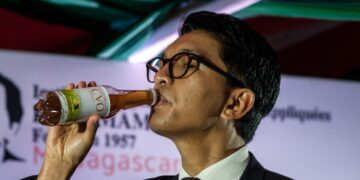 President Andry Rajoelina took a sip at the launch of Covid-Organics. Photo: Via Aljazeera / Henitsoa Rafalia/Anadolu
